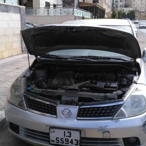 سيارة نيسان تيدا موديل 2006 لون سلفر ترخيص لشهر 2 بنتهي