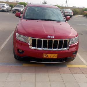 For sale 2011 Red Cherokee