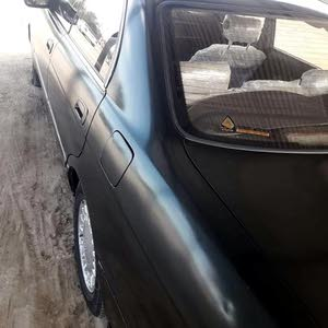بطة تيوتا كراون1995نظيفة رقم بغداد والسيارة مكانها بالناصرية