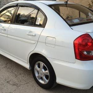 هونداي اكسنت موديل 2011 لون ابيض رقم بغداد .