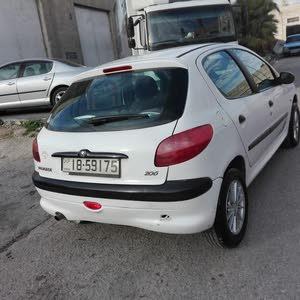 بيجو 206 فل عدا الجير 2002 فحص 2جيد بحالة ممتازة استخدام شخصي من الوكالة