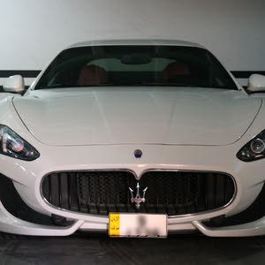 Yellow-plate Maserati Granturismo 2014