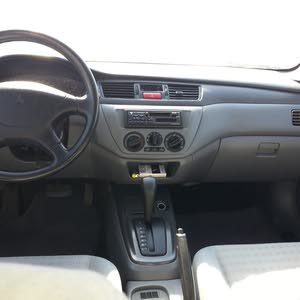 Used condition Mitsubishi Lancer 2006 with +200,000 km mileage