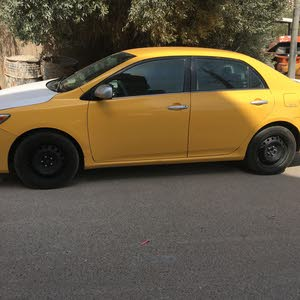 Toyota Corolla 2013 For sale - Yellow color