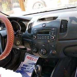 كيا سيراتو 2012 مكفوله بس ضربه على البارد بالجاملغ عكس السائق