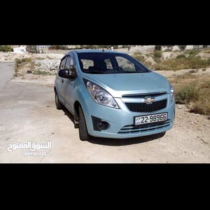 Manual Turquoise Chevrolet 2012 for sale