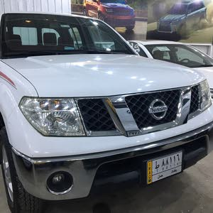 White Nissan Pickup 2010 for sale