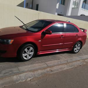 For sale 2009 Red Lancer