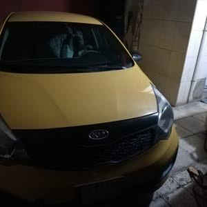 Kia Rio 2014 For sale - Yellow color