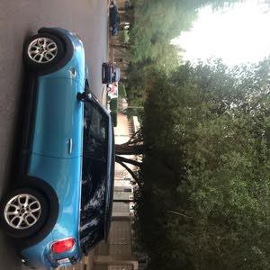 Turquoise MINI Cooper 2016 for sale