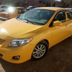 For sale 2009 Orange Corolla