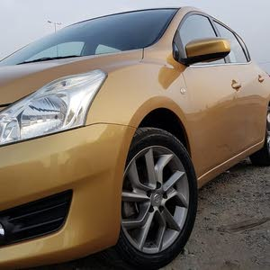Gold Nissan Tiida 2014 for sale