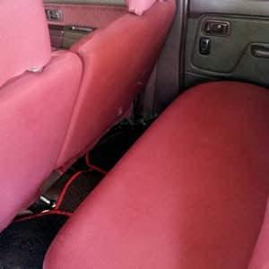 Maroon Nissan Pickup 2012 for sale