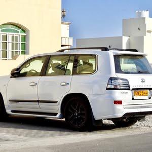 لكزس ال اكس 570 موديل 2010 وكالة عمان ابيض لولوي محول سوبرجارج وكالة