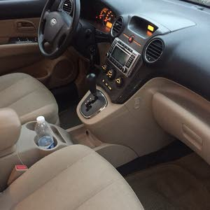 Grey Kia Carens 2012 for sale
