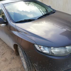 Kia Cerato 2012 For sale - Brown color