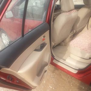 Maroon Kia Carens 2008 for sale