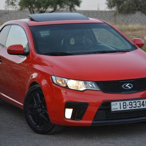 Kia Koup 2011 For sale - Red color