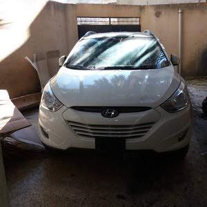 سيارة توسان بيضاء ماشية 6000لمعرفة سعر اتصل علي رقم 0924656065