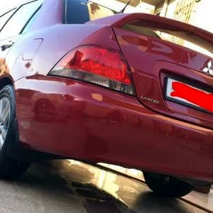 Automatic Maroon Mitsubishi 2012 for sale