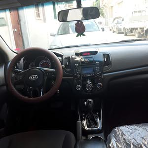 Automatic Maroon Kia 2012 for sale