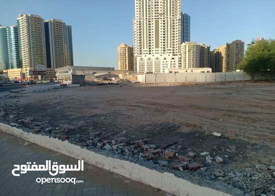 اراضى تجاريه بعجمان بشارع الشيخ خليفه