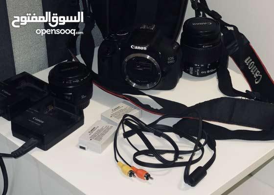 كاميرا وعدسات
