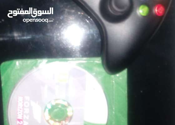 Xbox 360 for sale with a controller and 1 game