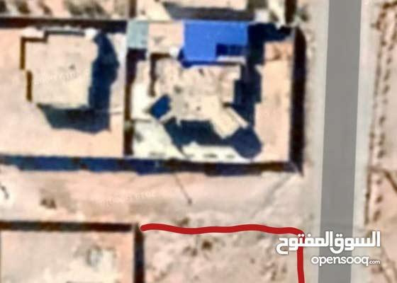 قطعة أرض - طريق المطار بني وليد