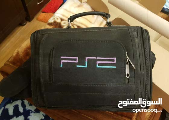 PlayStation 2 + games + memory card for sale