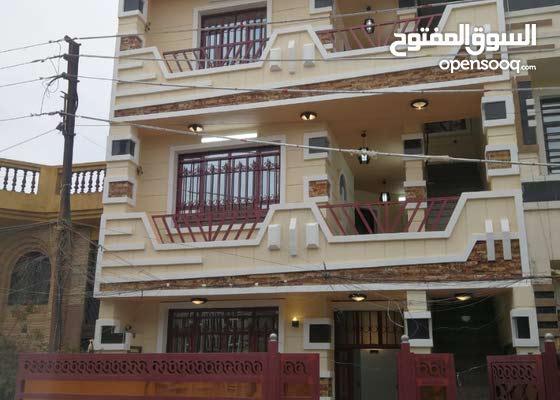 بناية سكنية أستثمارية حديثة في ضباط السيدية - شارع الكويتي (4 شقق سكنية)