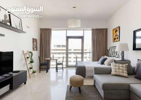 دبي البرشا 1مول الإمارات غرفه وصاله مفروشه مع بلكونه إيجار شهري شامل