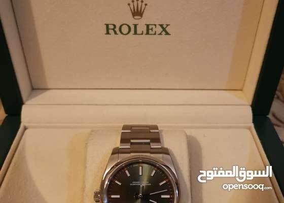 ساعة روليكس للبيع مع كامل مرفقاتها من وكيل محلي بالإمارات