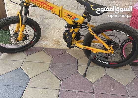 Land Rover yellow bike