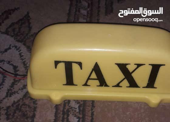 شعار TAXI