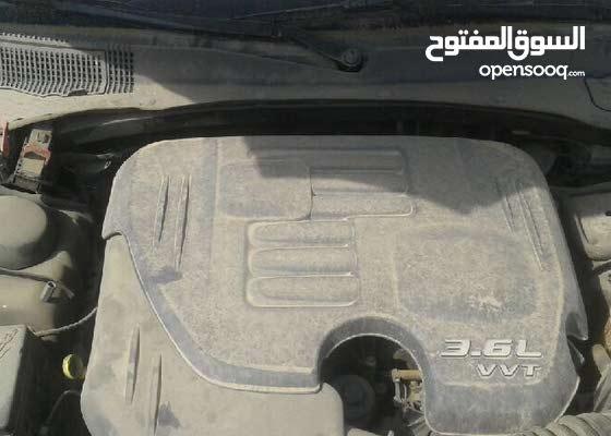 للبيع تشليح  دودج تشارجر موديل 2012ستاندراللون ابيض 6 سلندر V6 , حجم الماكينة 3.6L إ