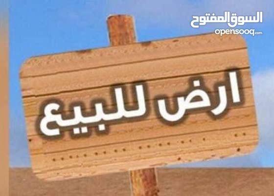 قطعة أرض بالحي الجامعي 2  بالقرب من مسجد الزهري