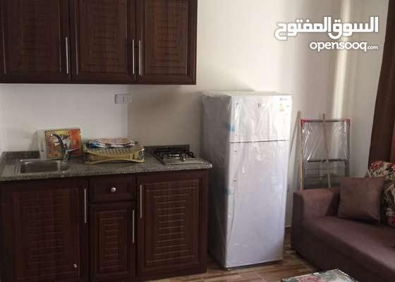 ستوديوهات مفروشة فرش كامل للايجار في شارع الجامعة الاردنية(شركة رائد خلف للاسكان)