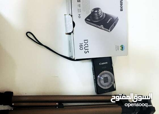 كاميرا كانون مع ستاند