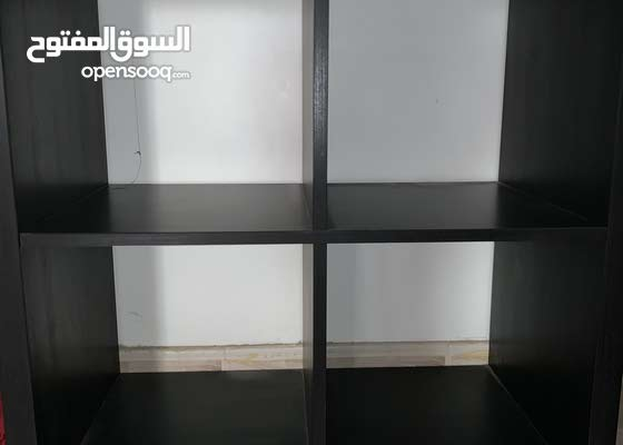 ikea black cabinet with four compartments