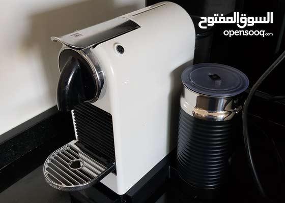 ماكينة قهوة نسبريسو مع كوب تسخين