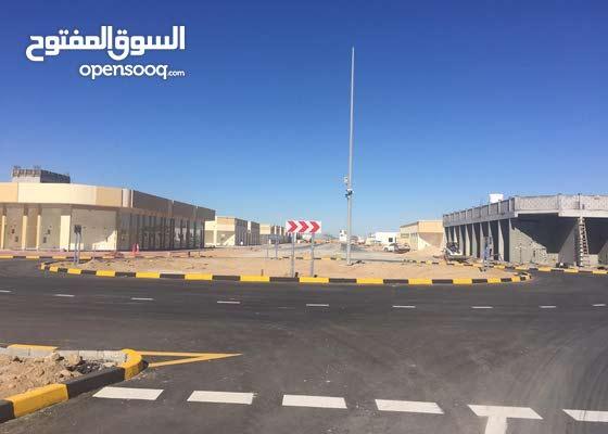 اراضى تصريح ارضى و 2 تجارى معفيه الرسوم على شارع متفرع من شارع الشيخ محمد بن زايد مباشره 300م