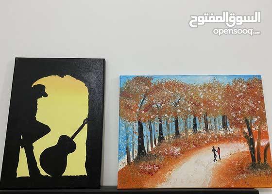 لوحة canvas بالالوان البرتقالي قياس(40*30) والسودة ( 40*20)