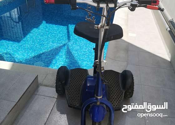 دراجه كهربائيه ثلاث عجلات