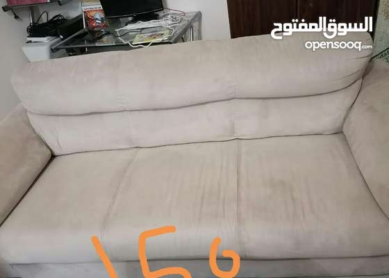 sofa 3 seaters in excellent condition = 120 2 single bed each one = 100 aed side