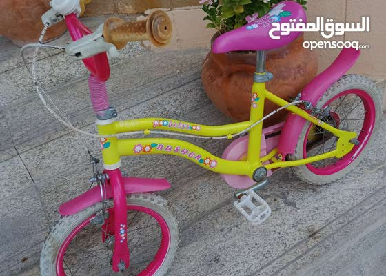 Kids girl bike 16in pink yellow in  great condition for sale