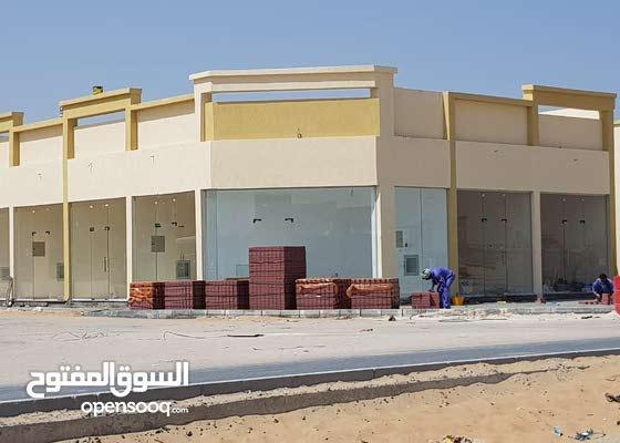 مبنى محلات تجارية للبيع فى الزاهية عجمان-تملك حر-كل الخدمات-عائد 10%