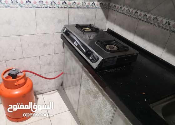طباخ غاز بعينين مع اسطوانة غاز