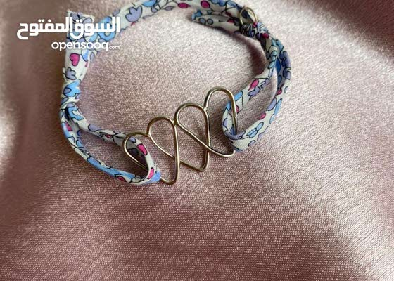 Triple Heart Real Silver bracelet in a unique rope