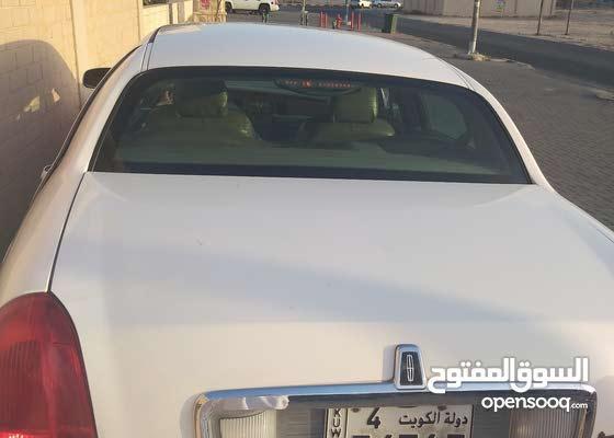 سيارة لينكولن2004 بيضاء